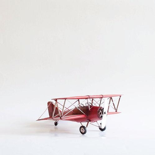 Avião metal vermelho