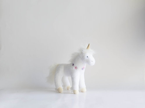 Unicornio pelúcia