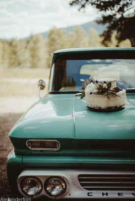 wedding cake on a car