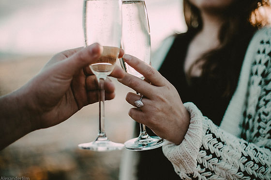 Engaged couple with champagne glasses