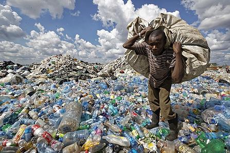 Kenyan Man carrying trash.png