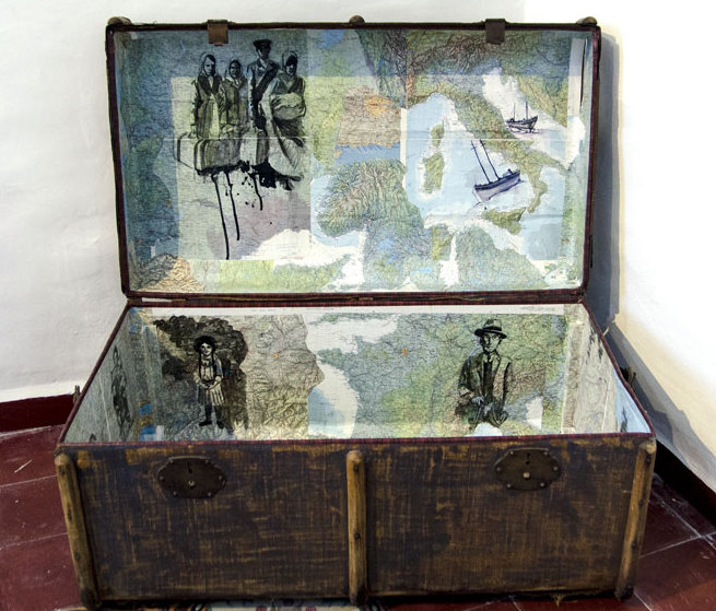 drawing on maps inside a traveling trunk