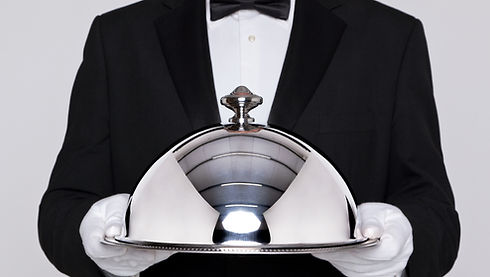 Waiter-serving-plate-with-serving-bell.j