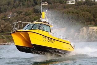 EM230 Yellow on top gun boat.jpg