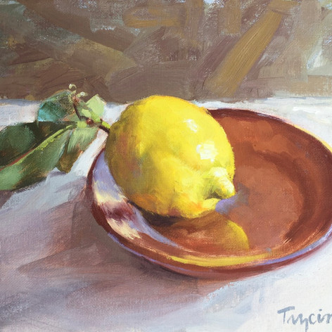 Lemon on Terracotta Plate