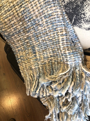 Pale blue chunky knit throw