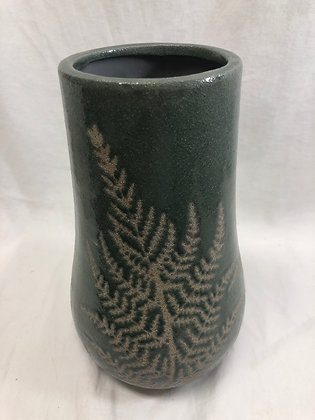 Small green vase with on trend fern motif . Height 23cm.