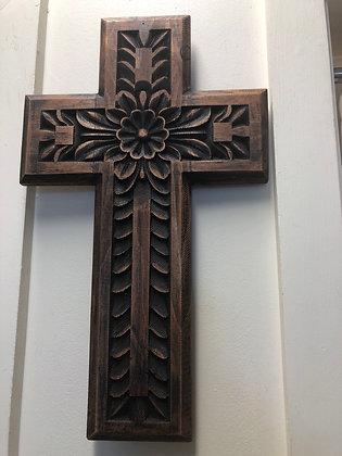 Brown wood carved cross