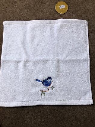 Blue bird face washer