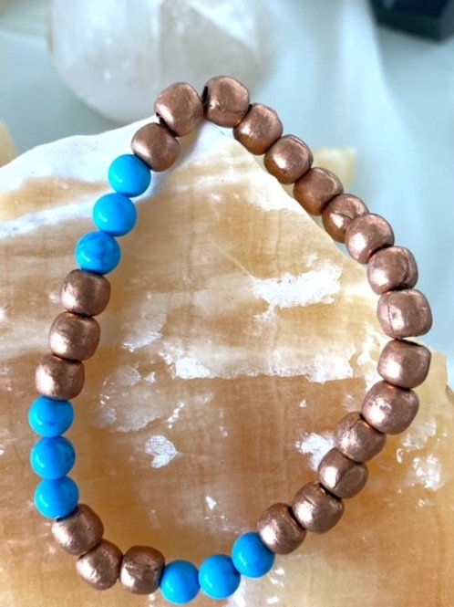 Beautiful stretchy handmade copper beads with sleeping beauty turquoise bracelet
