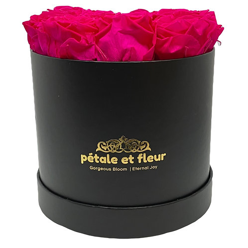 Twelve hot pink roses in a round black box