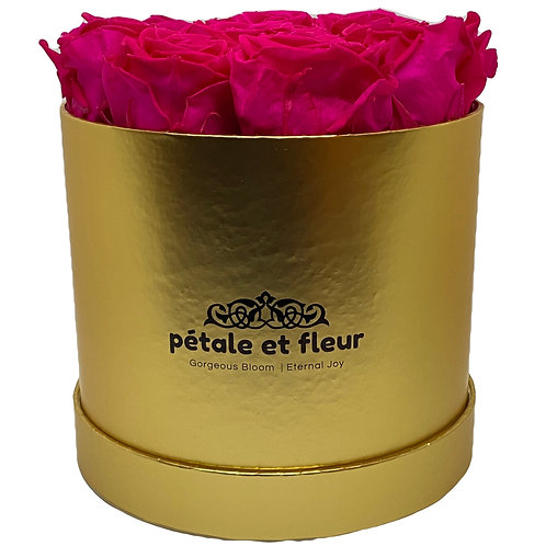 Twelve hot pink roses in a round gold box