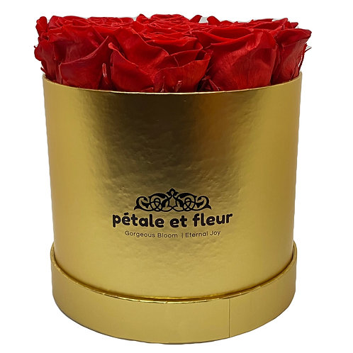 Twelve red roses in a round gold box
