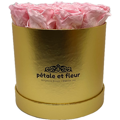 Twelve pink roses in a round gold box