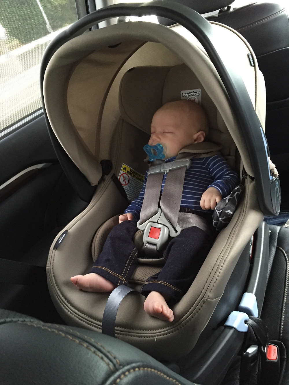 """Our son in the car seat, at 2 months old, weighing 11lbs and 22"""" long"""