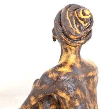 yellow woman sculpture