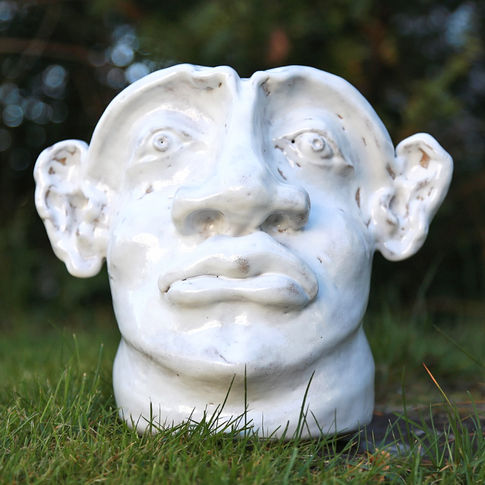 white face vase man