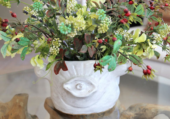 white face vase with flowers