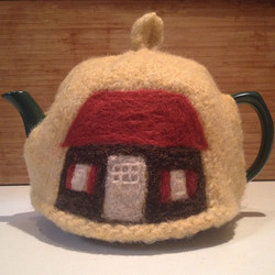 Tea cosy with cottage
