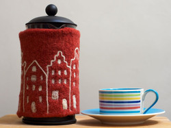 Coffee cosy with city scape