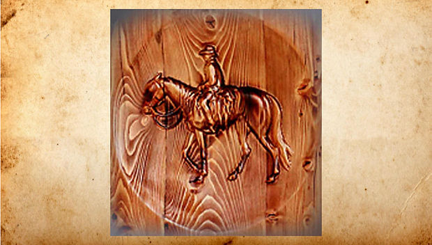 Custom carving of cowboy and bronco