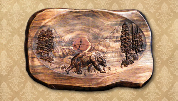 Beautiful wood carving of bear crossing an opening in the woods in the high country. The carving has been dramatically enhanced with the application of a torch to emphasize particular aspects of the wood. Approximately 32 x 16 x 2 inches, in Ponderosa Pine or Douglas Fir. $300.
