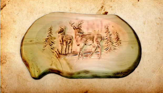 Nature's simplicity and innocence are well depicted in this wall hanging of two deer, a buck and a doe. The carving has been dramatically enhanced with the application of a torch to emphasize particular aspects of the wood. $300 plus shipping.