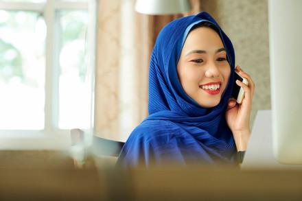 Pretty-muslim-woman-calling-on-phone-462
