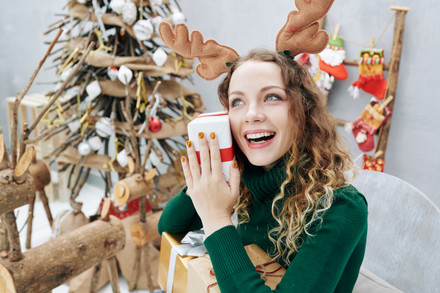 Excited-girl-holding-christmas-present-4
