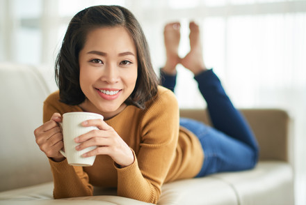 Young-woman-resting-on-sofa-528244.jpg