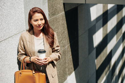Smiling-woman-with-coffee-cup-473445.jpg