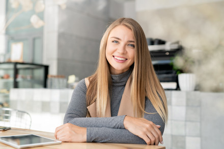 Happy-young-blond-busineswoman-in-438797