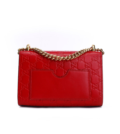 8ff059431745 A small structured Gucci Signature leather bag with a key lock closure  pulled from the archives