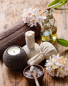 Spa concept with lilac flowers on old wo