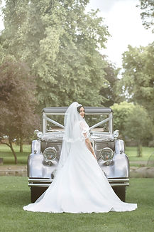 Bride with her car