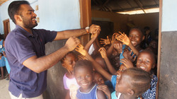 Volunteer, Wes, with FAWE students