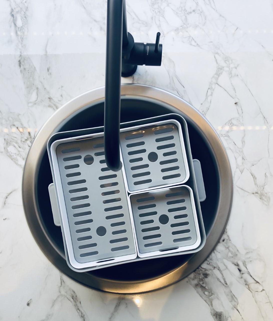 Soka Tub laundry soaking system fits in round sinks