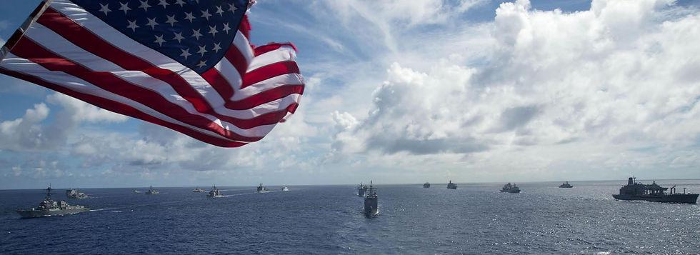 American flag and fleet of ships