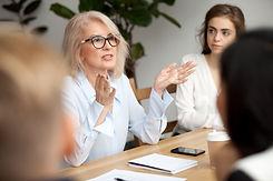 Attractive aged businesswoman, teacher o