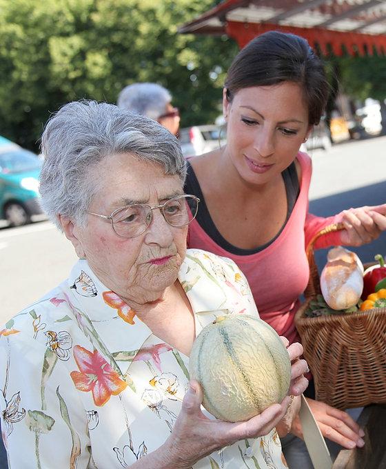bigstock-Young-woman-helping-elderly-wo-