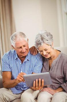 bigstock-Senior-couple-sitting-on-sofa--
