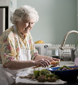 17512-an-elderly-woman-washing-produce-p
