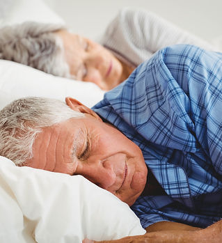 bigstock-Senior-couple-sleeping-on-bed--