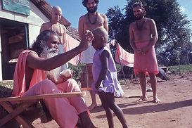 Sri Gurudev shaving a child