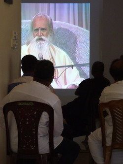 Watching a DVD of Sri Gurudev
