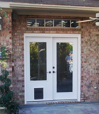 exterior door with pet door.  doors4petsandpeople home