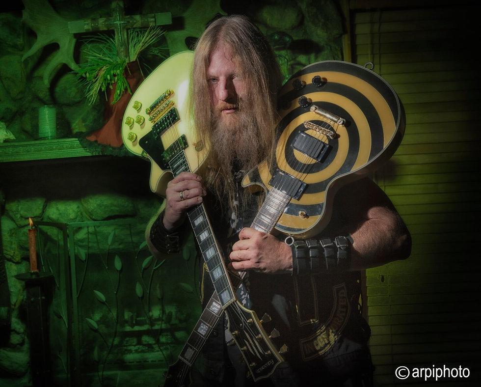 Johnny Blade guitars shoulder.jpeg
