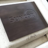 Bronzed exterior name plate at office building