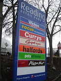Retail park signage with easily updated panels