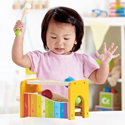 Little girl playing with a pound and tap musical toy